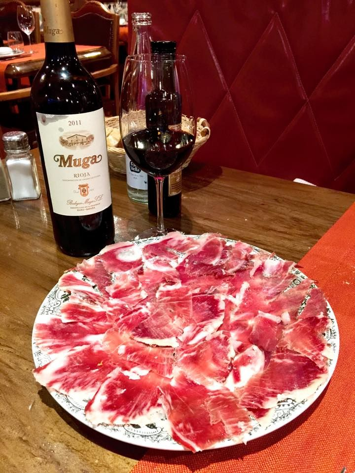 When the #BuddingWineMaker is in Spain, he can't miss a great Rioja #wine bottle with a delightful Jamón Ibérico. #barcelona #foodporn #food