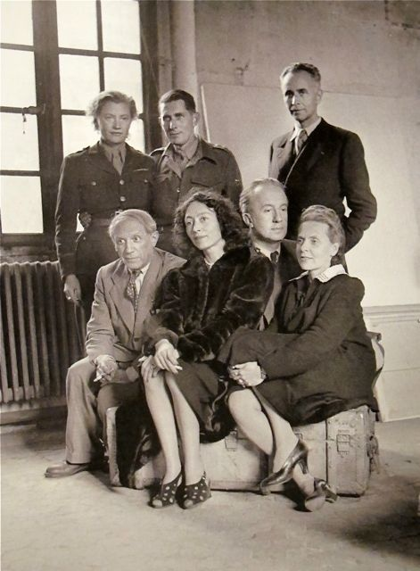 "Lee Miller:   ""Group Photograph (after the Liberation of Paris)""  L to R standing:   Lee Miller, Roland Penrose and Louis Aragon:  sitting: Picasso, Nusch Eluard.  Paul Eluard, and Elsa Triolet.  Picasso's Studio  Rue des Grands Augustins  Paris  1944"