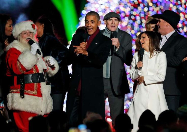 """President Barack Obama, sings """"Jingle Bells,"""" with Santa Claus, James Taylor, Eva Longoria, and Garth Brooks during the lighting ceremony for the 2016 National Christmas Tree on the Ellipse near the White House, Thursday, Dec. 1, 2016 in Washington."""