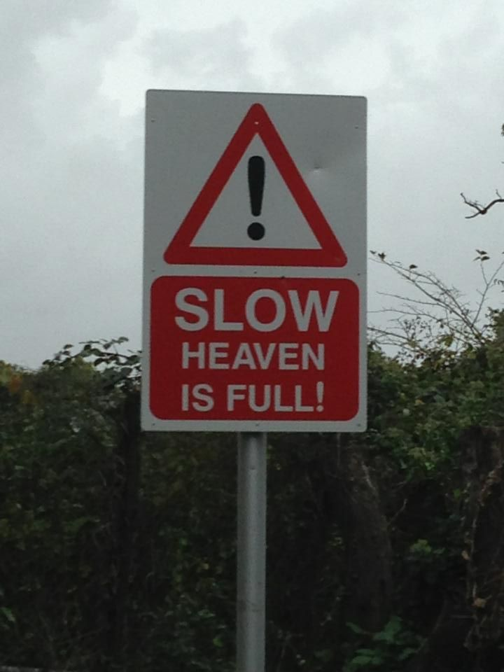Well, that's a different take on an accident black spot. Slow. Heaven is full road sign