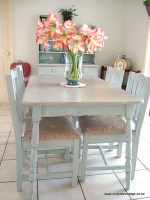 Restyled Vintage: repainted table and chairs in very pretty pale blue, I actually don't mind the oilcloth seats here.