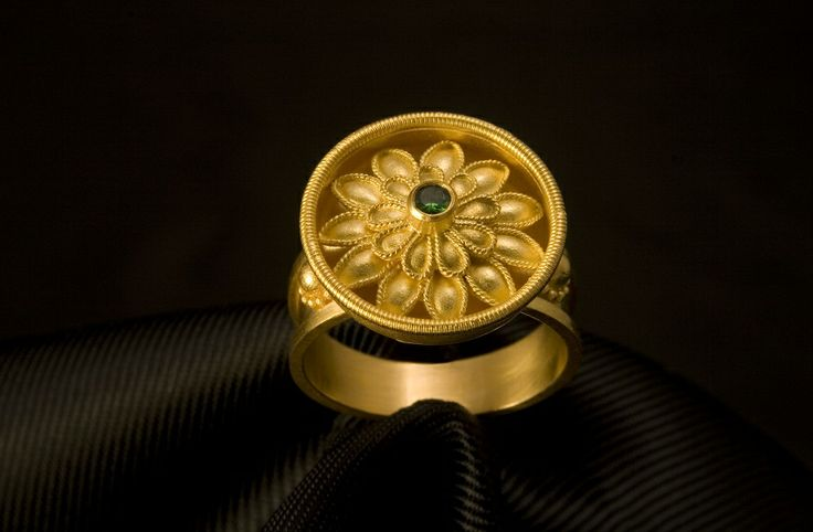 Handmade Ring in K22 Gold with a Tsavorite. Homage to the great artisans of the past.