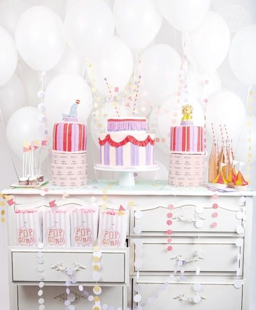 Love this vintage circus dessert table for a girl's birthday. Patels. Pink. Purple. Red. Love that confetti garland.