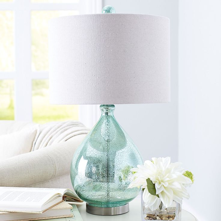 Our Mercury Glass Lamp With A Teal Luster And Ivory Colored Shade Is Worthy  Of