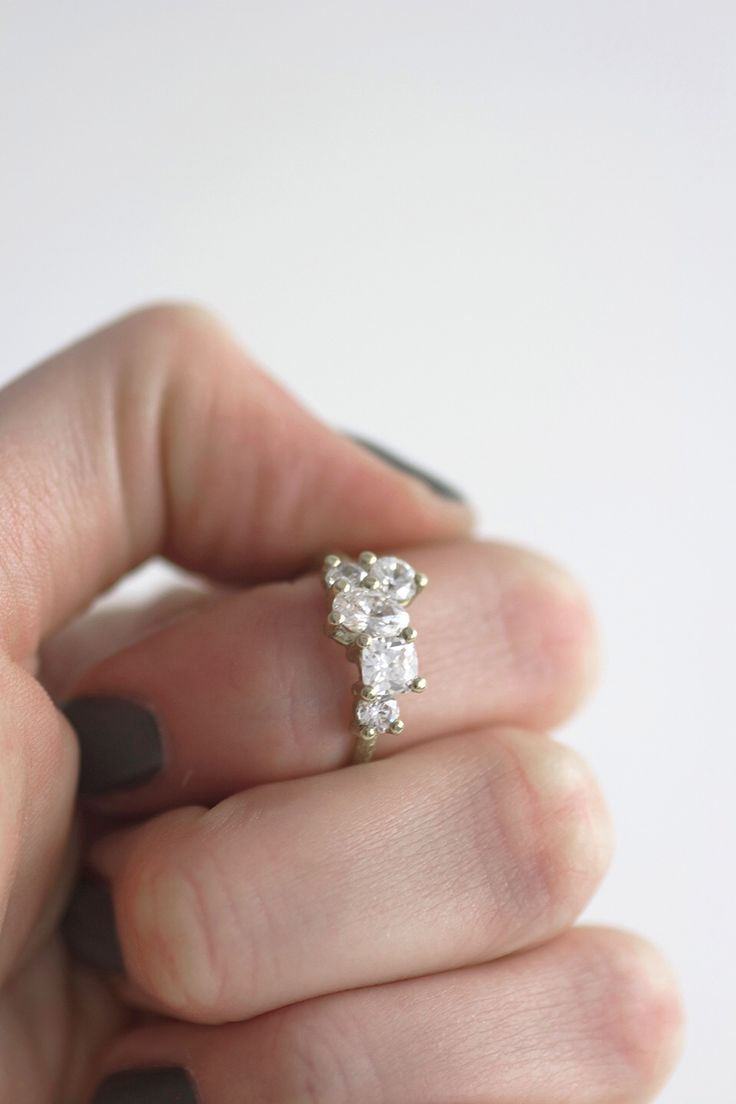 This white gold engagement ring has a VERY unique cluster of diamonds. So beautiful!