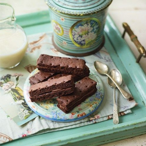 Chocolate Bourbon biscuit recipe. They're as easy to master as they are addictive. www.goodhousekeeping.co.uk