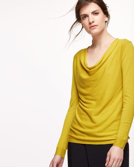 Created from a lightweight viscose and wool blend with a hint of cashmere, this flattering cowl neck sweater is the perfect transitional piece into autumn. Design features include full fashioning at the armholes and a centreback rib seam with hole detailing for a contemporary finish. Pair with jeans or tailored trousers for a versatile day-to-evening look.
