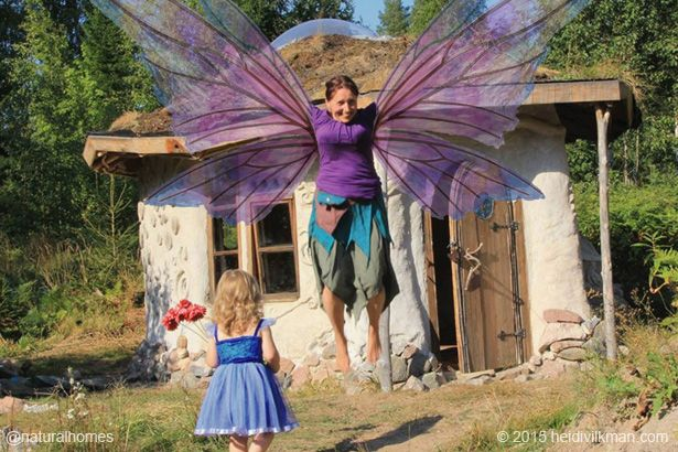 Heidi doesn't really have wings but her spirit does and that's what helped her to build a natural home setting a wonderful example for her children. Heidi is an artist and natural builder. You can see her work at www.etsy.com/shop/HeidiVilkman and see more of her home at www.naturalhomes.org/heidi-update.htm