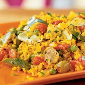 Vegetarian Paella- This Spanish classic is simple to prepare and easily doubled to serve a crowd. Artichokes, bell peppers, mushrooms and olives cooked with nutty brown rice make this a hearty one-dish meal. The blend of exotic spices including saffron and tumeric give an extra special flavor.