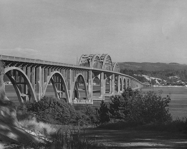 Alsea Bay Bridge at Waldport, Oregon by OSU Special Collections & Archives : Commons, via Flickr. This is a picture of the original bridge.