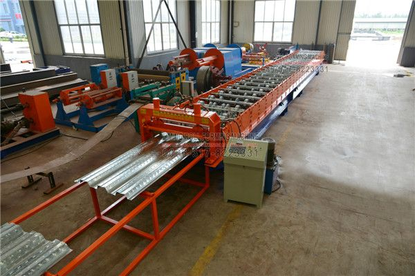 The #Roll #Forming #Machine #for #Steel #Structure #Floor is  consists of decoiler,flattening system.roll forming machine,PLC control system,hydraulic cutting system and run-out table.This machine is fully automatic and it will be a money maker for you.