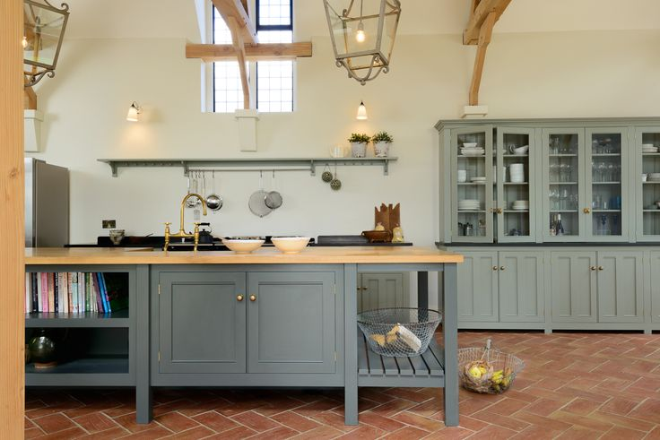A beautiful deVOL Classic English Kitchen with a mix of honed black granite and oiled oak worktops