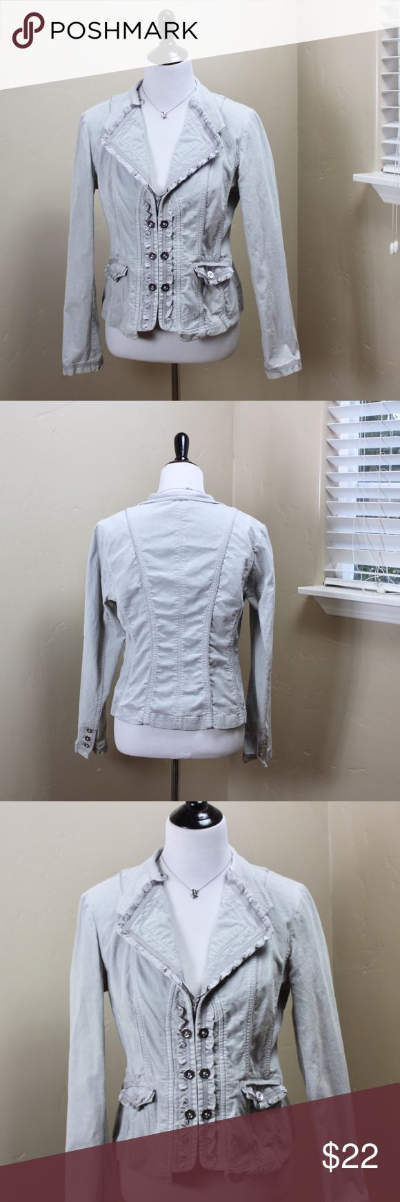"White House Black Market Jacket WHBM Jacket.  Light gray corduroy jacket with hook & eye closures & ruffle trim. Fitted jacket (98% cotton, 2% spandex)  with silver accent buttons. Size tag is missing. WHBM measures this an 8/10. Listing as a medium - closer to an 8. Flat approx measurements: 19.5"" pit to pit, 17"" waist, 19"" hips. Notable flaws - last pic. Discoloration at bottom of sleeves & under pits. Only notable when making field goal calls or stretching your wrists out to be arrested…"