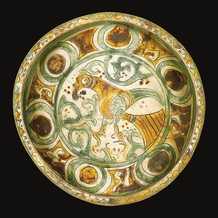 A Rare Aghkand Sgraffiato pottery bowl, Persia, 12th-13th century