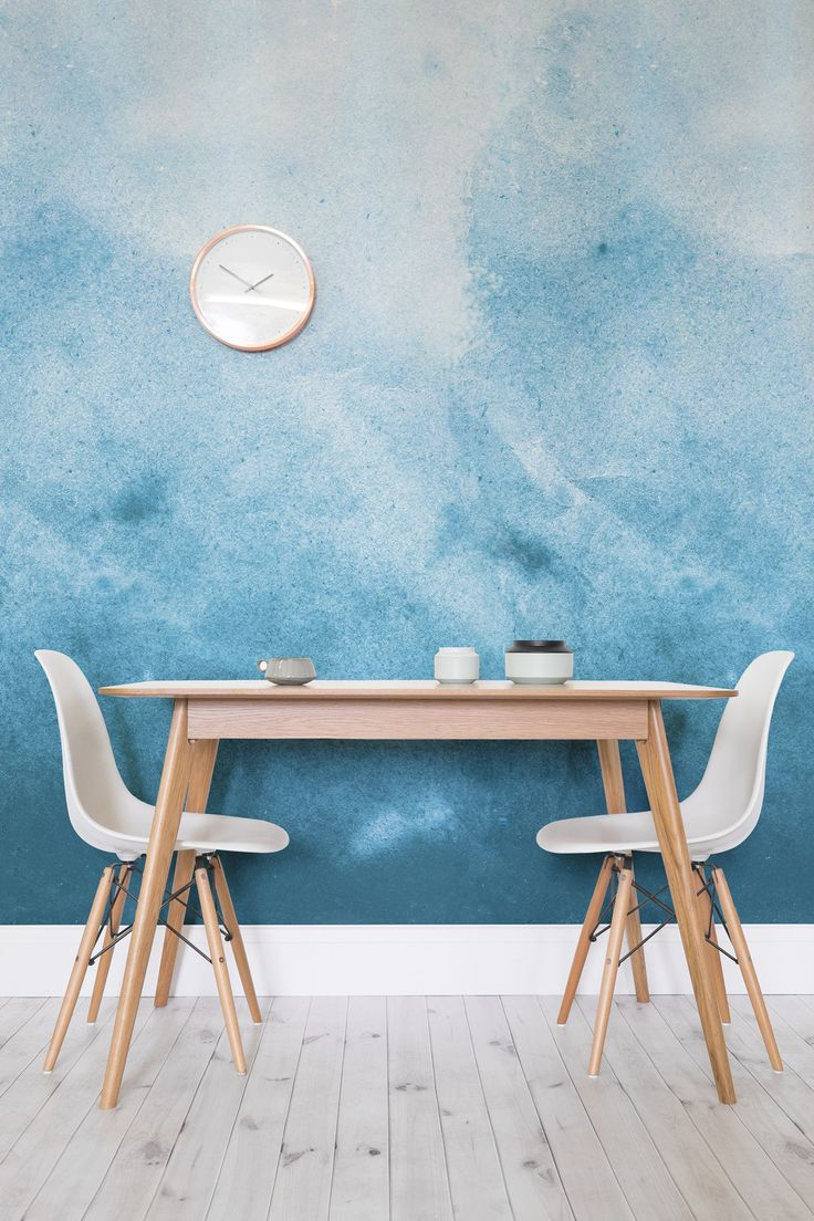 A modern take on blue painted walls. This blue watercolour wallpaper design brings depth and texture to your forgotten about dining room walls.
