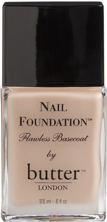 "Butter London: Nail Foundation Flawless Base Coat / "" Make up for your nails...provides the perfect foundation...our base coat hides and smoothes tiny ridges and imperfections in the nail. It is like cover-up, or foundation make-up for the nail.  It leaves a silky, matte finish when used alone...an invisible, but immaculate manicure. When used as base coat, it provides a beautiful, smooth surface on which to paint..."""