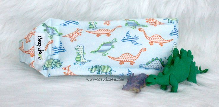 Is there a dinosaur lover in your car?  Let this cute head support help your little one sleep better in the car. Find out more at www.cozydozee.com