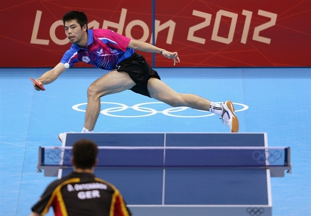 Best Of London: Day 6 - Slideshows | Chih-Yuan Chuang of Chinese Taipei plays a shot during Men's Singles Table Tennis Bronze medal match.  (Photo: Feng Li / Getty Images) #NBCOlympics