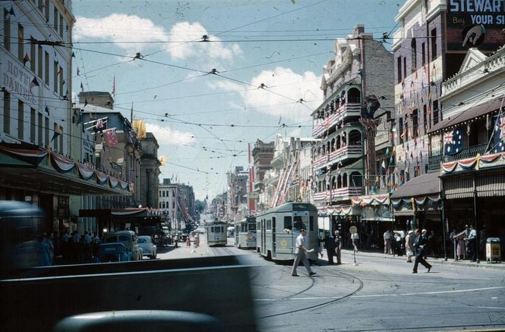 Brisbane / Australia. View along Adelaide Street from George Street with the buildings decorated for the Royal Visit, 1954.