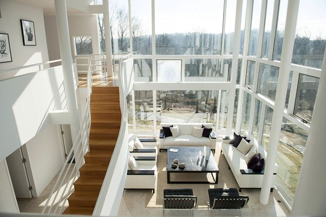 This contemporary house in Mount Kisco, N.Y., was designed to take advantage of views of the surrounding woodland from its hilltop location, with separate living and entertaining spaces. (Photo: Rayon Richards for The Wall Street)