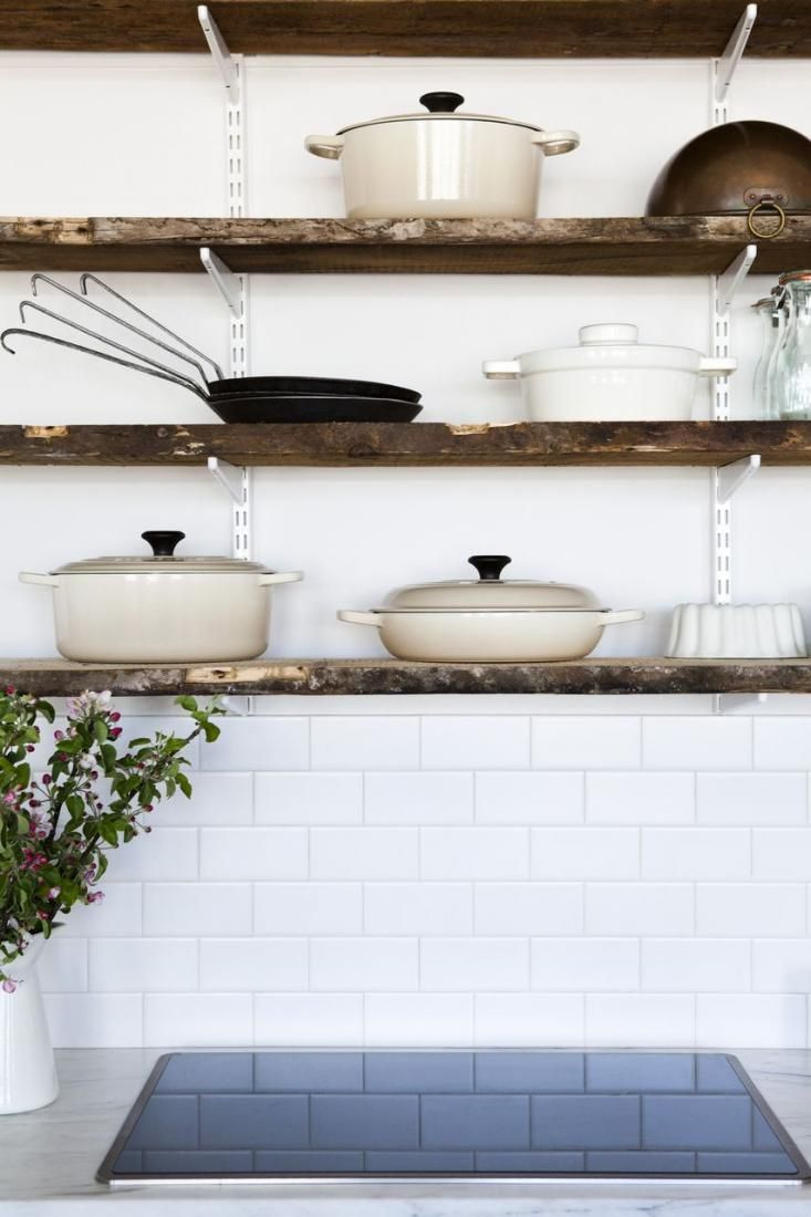 Ah, shelves don't have to be very complicated: Old-school hardware with distressed-looking wood. Food 52 Le Creuset