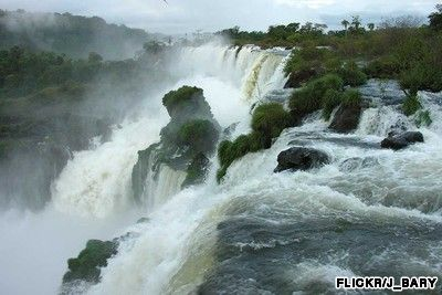 The Iguazú River drops up to 82 meters over a 2.7 kilometer-wide ledge of the Paraná Plateau. The waterfalls are accessible from Brazil, Argentina and Paraguay.  A walk through the national park will take you not only to the Devils Throat and close to the curtain of water, it will also give you a chance to spot coral trees, butterflies, toucans and hummingbirds.