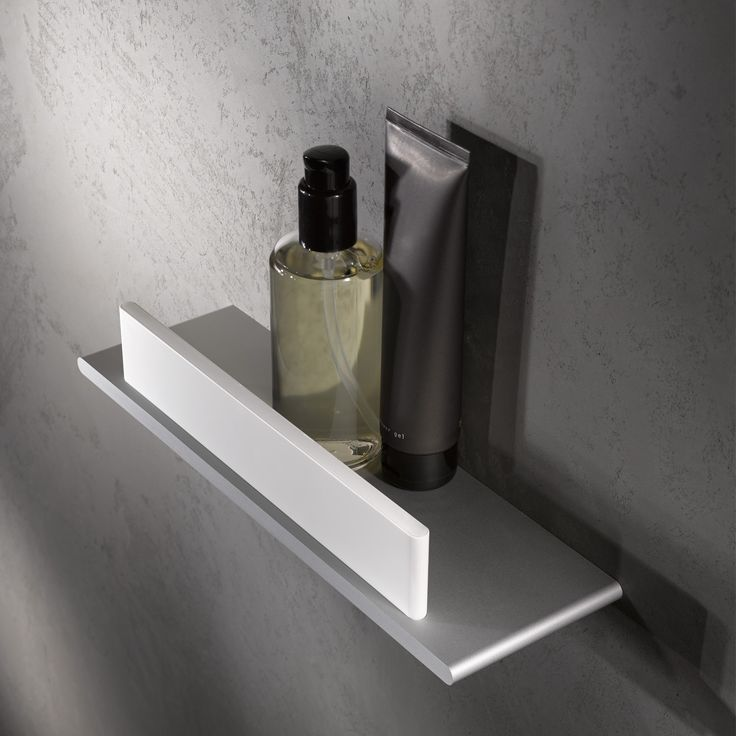 the edition 400 shower shelf has an integrated glass wiper perfect for squeegeeing shower doors