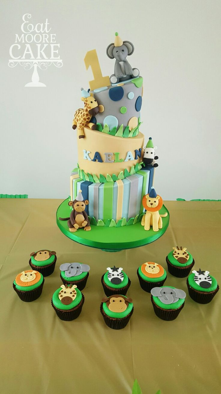 Jungle theme 1st birthday cake with matching cupcakes!