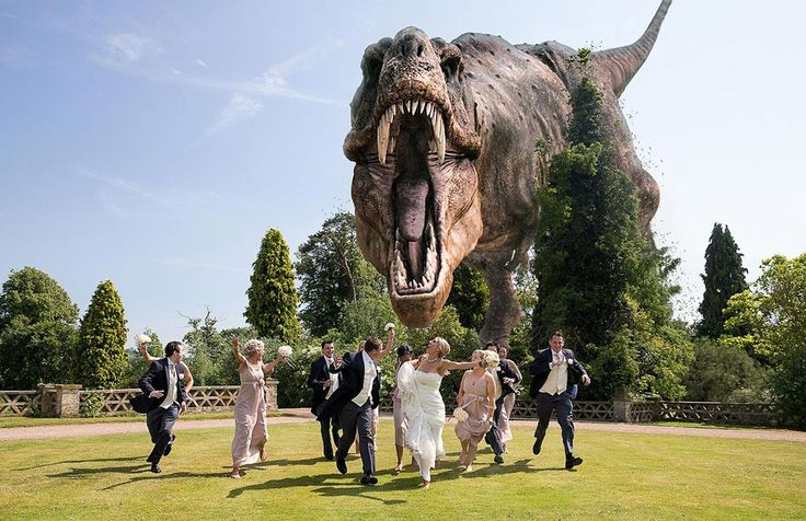 Wedding guests running from a dinosaur