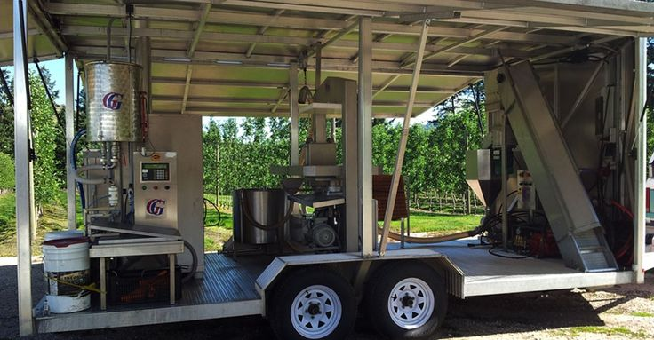 the mobile juicing trailer open with all machinery