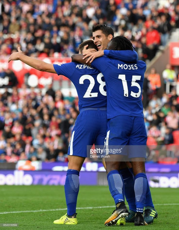 Alvaro Morata of Chelsea celebrates scoring his sides fourth goal with his Chelsea team mates during the Premier League match between Stoke City and Chelsea at Bet365 Stadium on September 23, 2017 in Stoke on Trent, England.