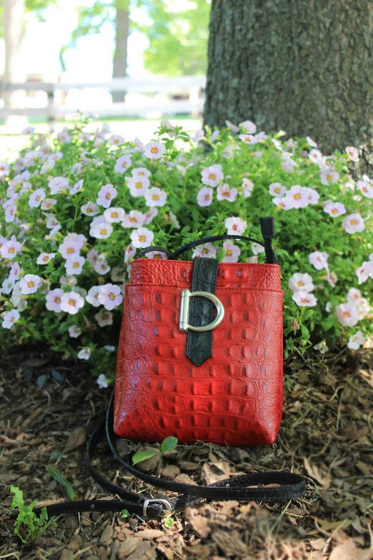 Look at this cute half bit handbag. It has 3 pockets to keep you organized. Caracol - Inspired Jewelry and Handbags - Italian Calfskin Leather Crossbody Handbag by Moda in Pelle.