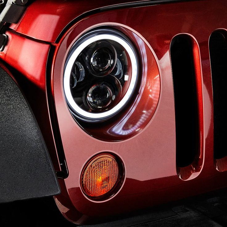 """Lumen® - 7"""" Round Black Projector LED Sealed Beam Headlights with Switchback Halo Installed on a Jeep Wrangler, Halo Ring On"""