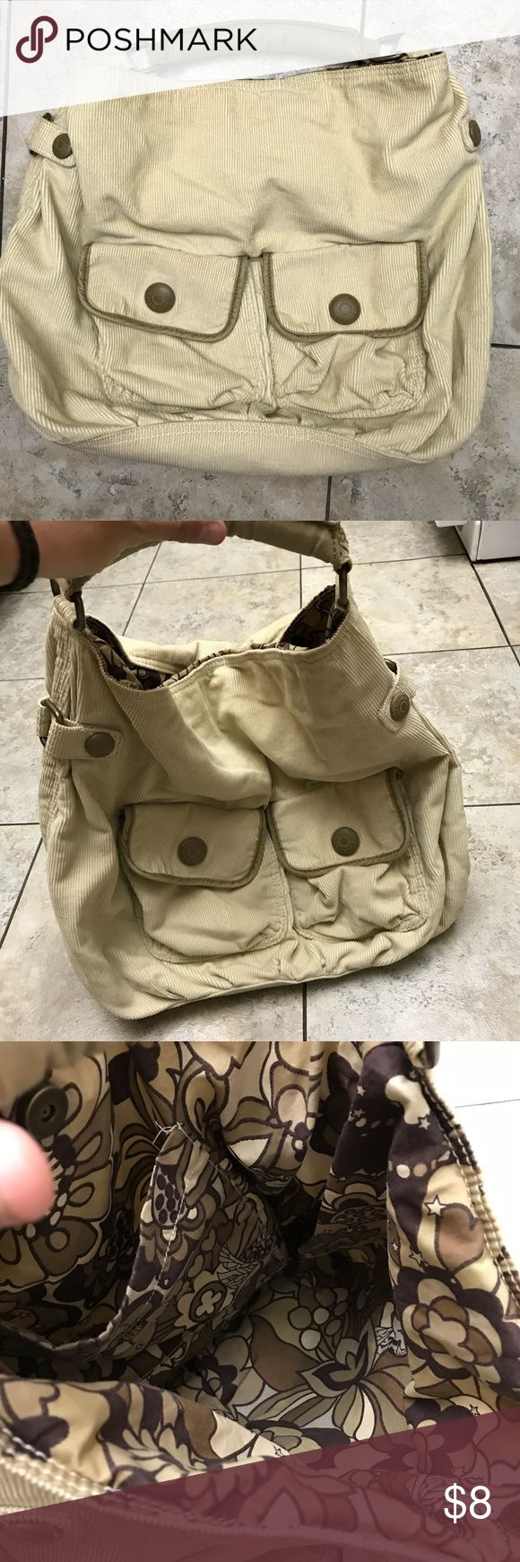 GAP purse Like never never carried  Beige in color  Spotless on inside  Magnetic closure   Front pockets  Approx 17 inches wide by 15 inches deep GAP Bags