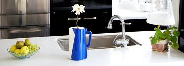 Vertu De Carafe Paper Dispenser and Vase. This multi-functional paper towel holder also hides a stem vase. A bright and fun addition to any kitchen. Available in other colors.