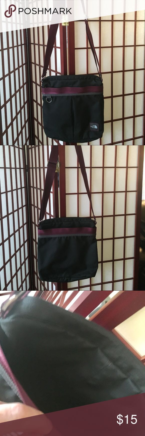 NorthFace cross body bag black/burgundy Gently used, in amazing condition, has a light white mark on the back. Maybe it will even wash out. North Face Bags Crossbody Bags