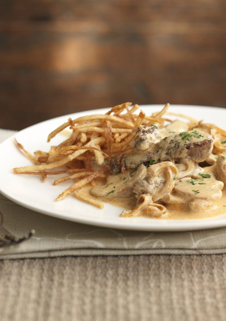 A real classic. Beef stroganoff with matchstick potatoes by Rick Stein.
