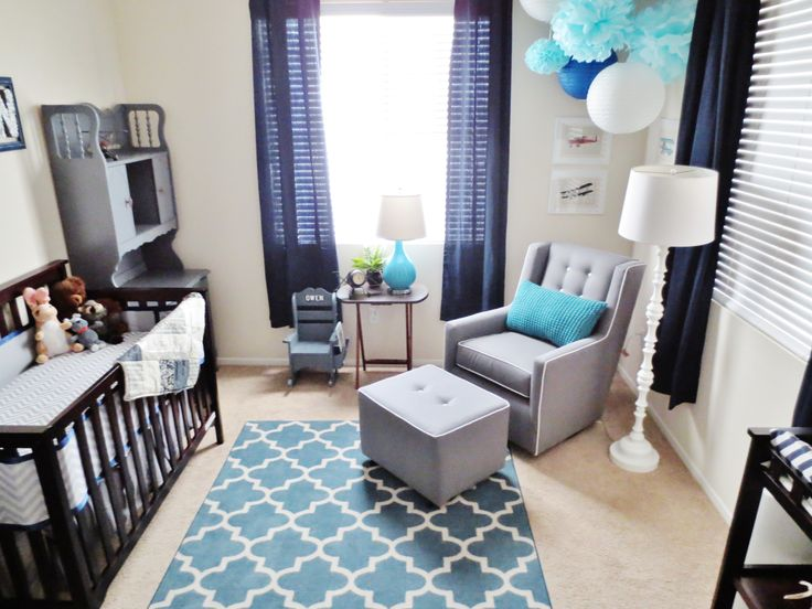 My baby boys nursery. Dark blue, gray and teal. Vintage Airplanes add the finishing touch.