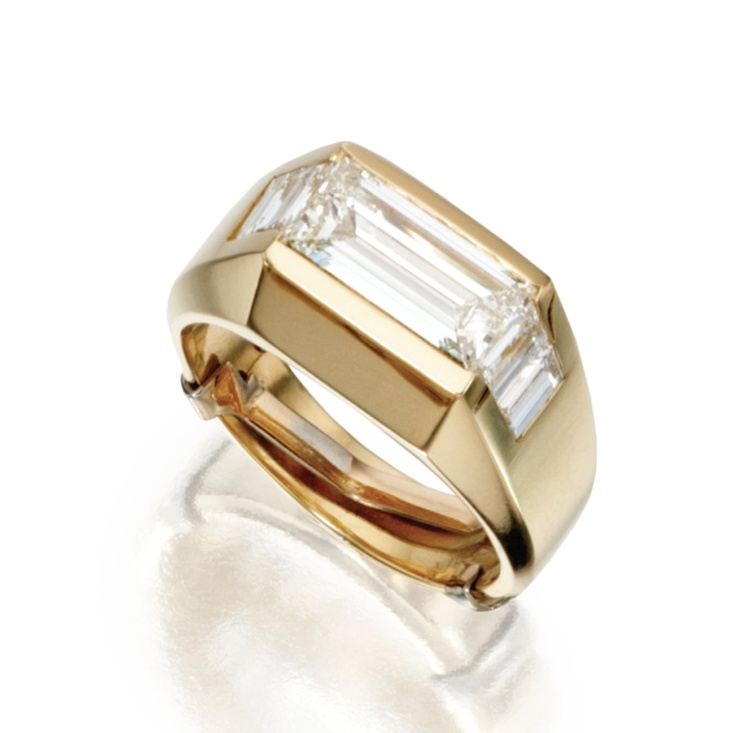 18 KARAT GOLD AND DIAMOND RING The emerald-cut diamond weighing 2.74 carats, flanked by baguette diamonds weighing approximately .85 carat, size 10.