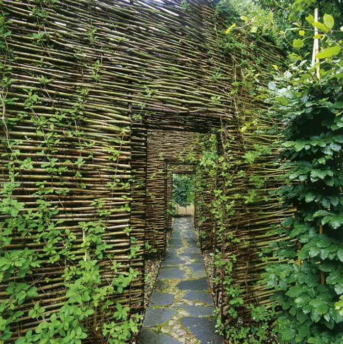Mill House | Västra Karup, Sweden • Windgardhs. A succession of woven willow screens creates a path to the Mill House and its sauna.