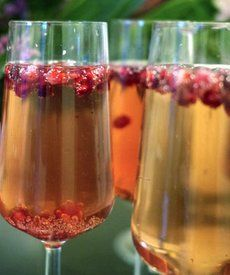 Pomegranate Pear Bellini:    2 tablespoons pear purée    Champagne or sparkling wine    Splash pomegranate juice    Pomegranate seeds for garnish—optional    Directions    1. Pour pear puree into the bottom of a champagne flute. Top with sparkling wine. Add a splash of pomegranate juice. Drop in a few pomegranate seeds.