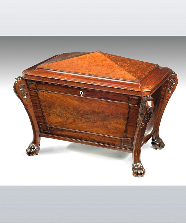 A Regency mahogany cellarette; of sarcophagus form, the legs carved with anthemions to the knee and terminating in lion paw feet. Veneered through out with blister mahogany c.1810 #wine #storage