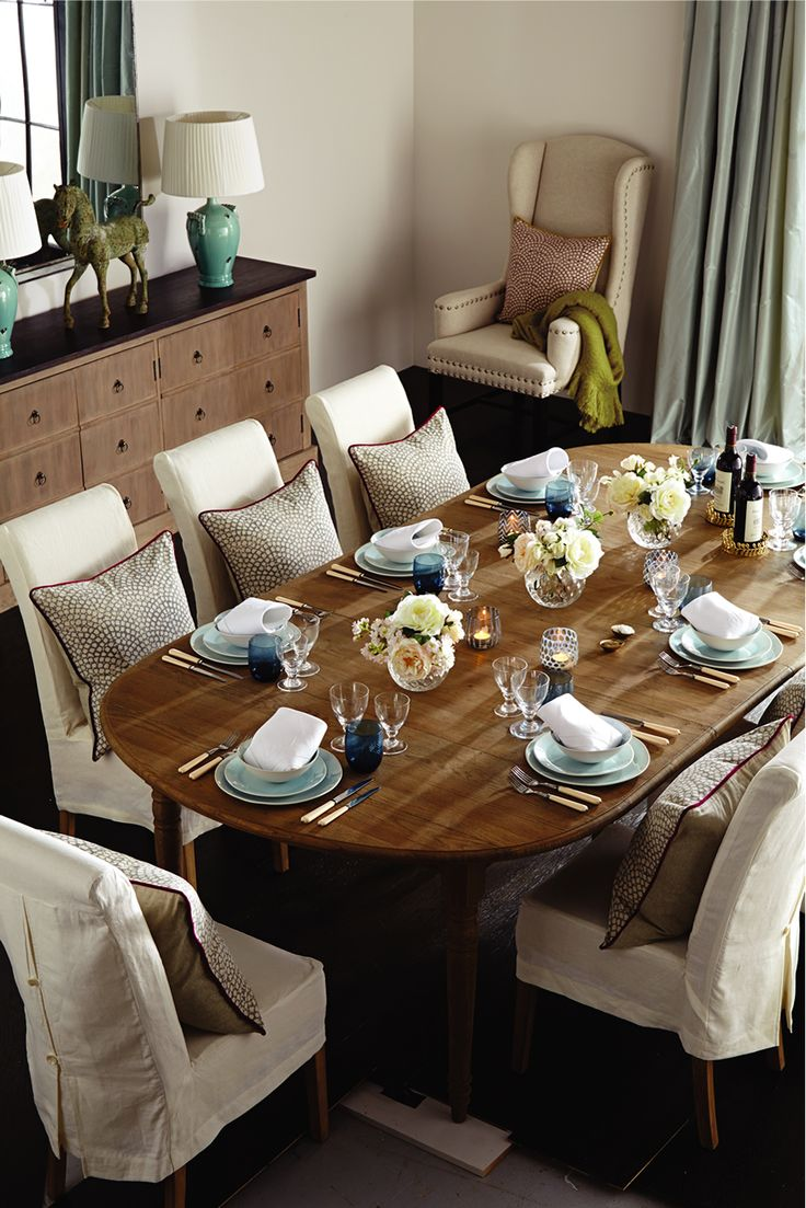 Different shades of blue across china and glass tumblers gives this table a fresh and colourful spring look for the evening. Everything is quite classic with elegant cream flower arrangements taking centre stage and a crisp white napkin as the finishing touch at each place setting. #dinner #spring #oka #dining