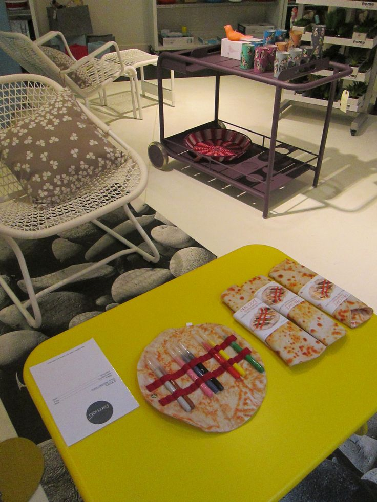 """pen-cakes"" on a Sixties low table by Fermob, with a Sixties armchair and a Luxembourg side table"