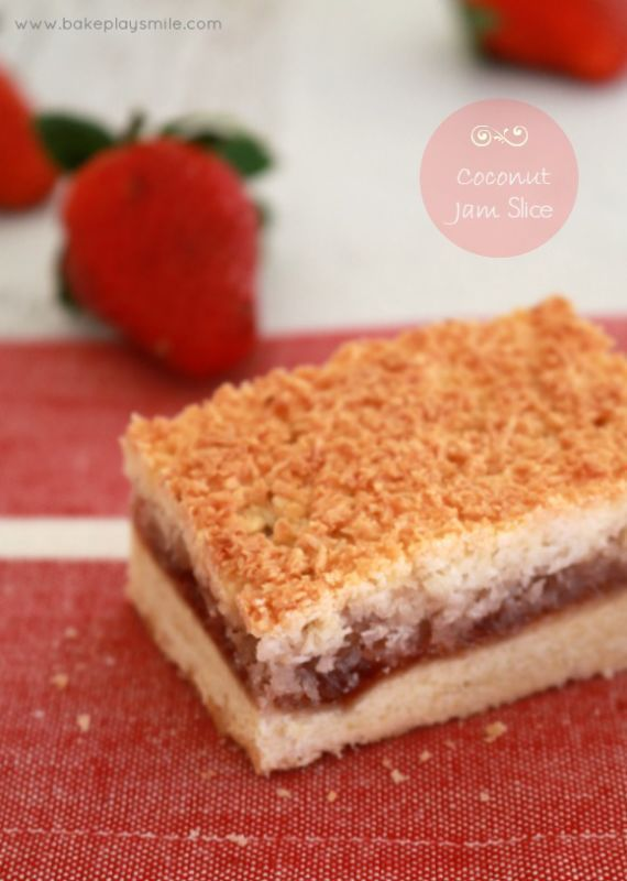 Coconut Jam Slice is such a classic recipe! The delicious triple layers include a shortbread-like base, fruity jam centre and crispy coconut topping.