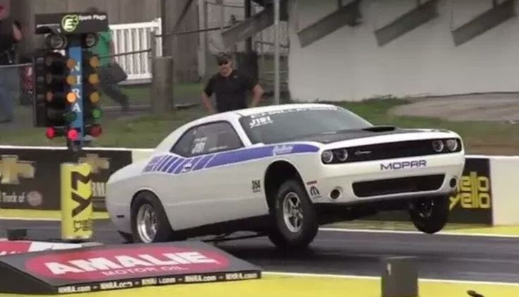 New Dodge Challenger Drag Car Hanging out the front tires