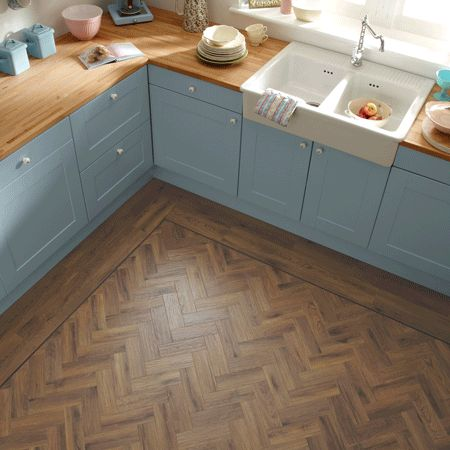 Kitchen with Karndean Art Select AP06 Morning Oak Flooring  laid herringbone with a border of Art Select HC02 Morning Oak planks and a feature strip DS07 Coffee.