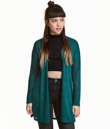 Emerald green. Wide-cut cardigan in a soft, fine knit with long sleeves, dropped…
