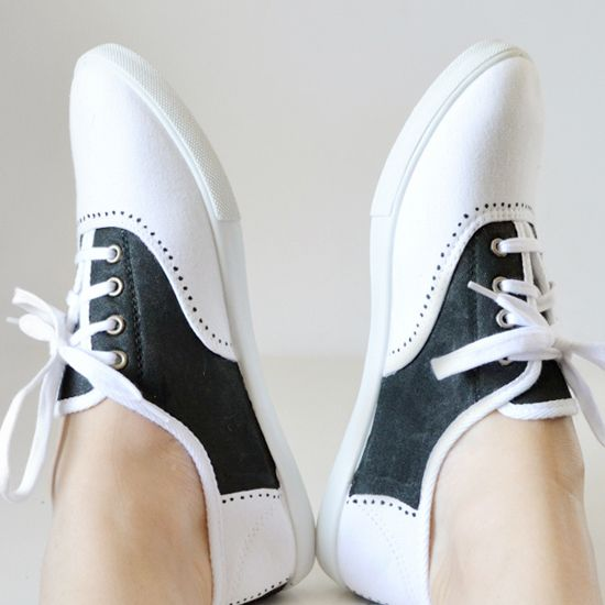 All you need is a little bit of fabric paint and a pair of white canvas sneakers to have your own painted saddle shoes. Great for dress up or Halloween!
