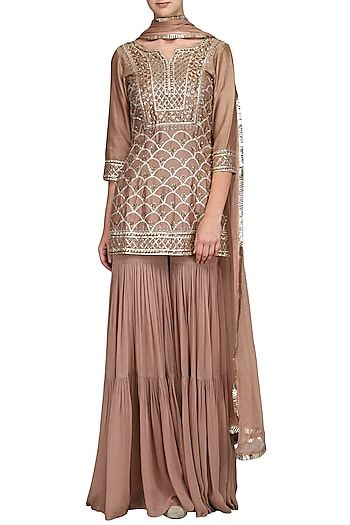 fb63678dc0 Esha Koul Featuring a champagne gold short kurta in georgette base  embellished with gota patti work all over. It is paired with matching  sharara pants and ...